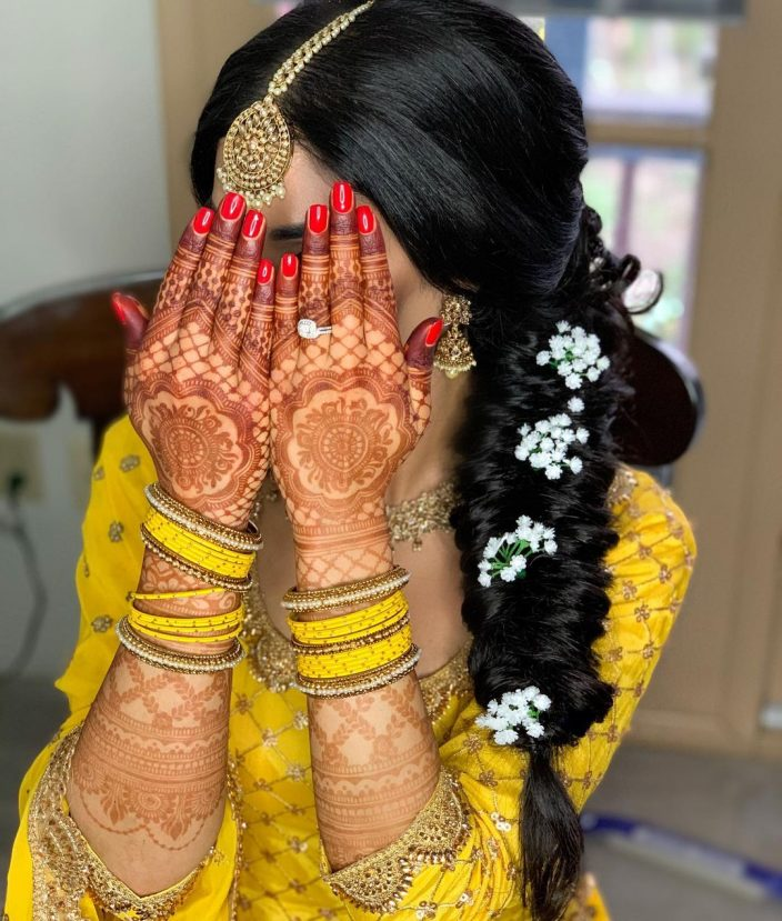 Long fishtail braids hairstyle for the Islamic bride