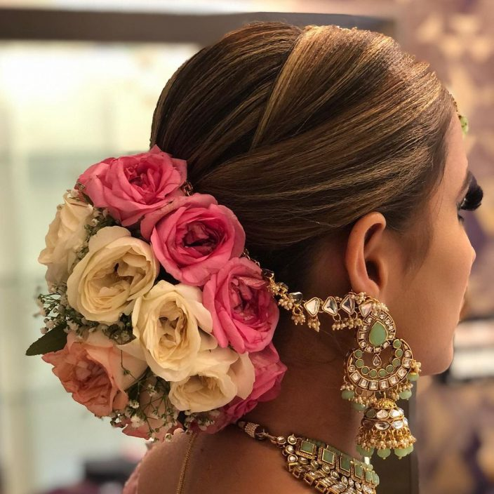 Floral bun bridal hairstyle for the Indian bride